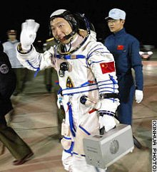 A relaxed Yang Liwei waves to well-wishers as he prepares to board the Shenzhou 5 capsule and take a ride into history
